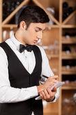 Waiter making notes. — Stock Photo