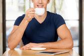 Drinking coffee at restaurant. — Stock Photo