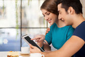Couple with digital tablet. — Stock Photo