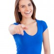 Beautiful young smiling woman pointing you — Stock Photo