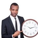 African man holding clock — Stockfoto