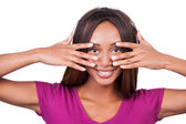 African woman holding fingers on face — Stock Photo