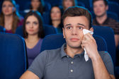 Man crying at the cinema — Stock Photo