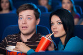 Couple eating popcorn and drinking soda — Stock Photo