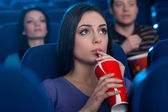 Watching an exciting movie. — Stock Photo