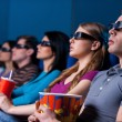 People enjoying three-dimensional movie. — Stock Photo #41222129