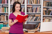 Woman in library. — Stock Photo