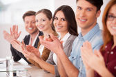 Group of young people sitting and applauding to you — Stock Photo