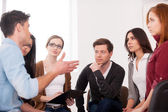 Man telling something for group of people — Stock Photo