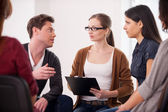 Group of people sitting close to each other while man telling something — Stock Photo