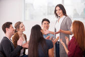 Woman telling something and gesturing for group of people — Stock Photo