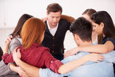 Group of people sitting in circle — Stock Photo