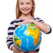 Girl holding a globe — Stock Photo