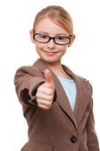 Girl in formalwear with  thumb up — Stock Photo