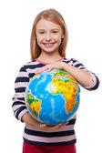 Girl holding a globe — Stock Photo