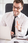 Man in shirt and tie pointing you and smiling — Stock Photo