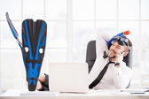 Office worker in snorkel and flippers gesturing and smiling — Stock Photo
