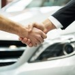 Hands shaking in front of the car — Stock Photo #41946987