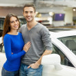 Couple standing at car dealership and making their decision — Stock Photo #41947175