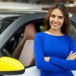 Womstanding near her new car at dealership — Stock Photo #41947213