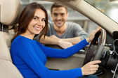 Couple are examining a new car at the dealership — Stock Photo