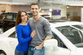 Couple standing at the car dealership and making their decision — Stock Photo