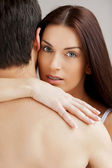 Woman hugging her boyfriend and looking at camera — Stok fotoğraf