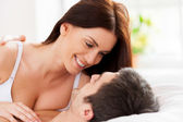 Loving couple in bed — Stock Photo