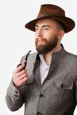 Portrait of man in formalwear smoking a pipe — Stok fotoğraf