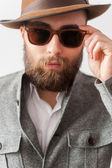 Man in casual wear adjusting his sunglasses — Stock Photo