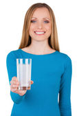 Woman holding a glass with water and aspirin in it — Stock Photo