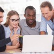 Group of business people looking at the laptop — Stock Photo #42491385