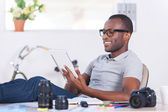 African man in casual wear working on digital tablet — Stock Photo