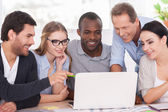 Group of business people  looking at the laptop — Stock Photo