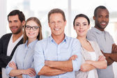 Group of business people keeping arms crossed — Stock Photo