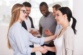 Women shaking hands — Stock Photo