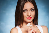 Woman Smiling and Holding flower — Stock Photo