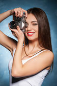 Woman focusing with camera — Stock Photo