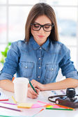 Businesswoman in casual wear writing — Stock Photo