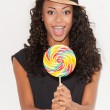 African woman holding lollipop — Stock Photo