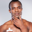 African man applying cream at face — Stock Photo #43644561