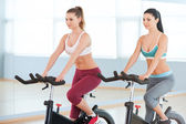 Cycling on exercise bikes. — Stock Photo