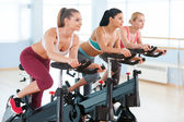 Cycling on exercise bikes. — Stock Photo