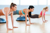 Women doing push-ups. — Stock Photo