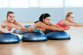 Women stretching together — Stock Photo