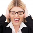 Businesswoman keeping eyes closed and covering ears — Stock Photo