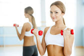 Woman with dumbbells. — Stock Photo