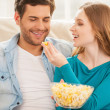 Couple eating popcorn. — Stock Photo