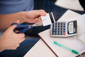 Woman cutting a credit — Stock Photo