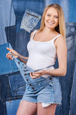 Pregnant woman in jeans clothes — Stock Photo